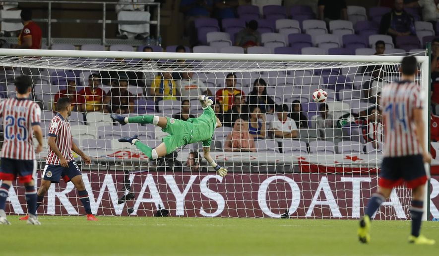 Mexico's Guadalajara goalkeeper Raul Gudino fails to stop a kick by Japan's Kashima Antlers Abe Hiroki during the second round of the Club World Cup soccer match at the Hazza Bin Zayed stadium in Al Ain, United Arab Emirates, Saturday, Dec. 15, 2018. Kashima Antlers won 3-2. (AP Photo/Hassan Ammar)