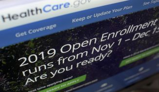 This Oct. 23, 2018, file photo shows HealthCare.gov website on a computer screen in New York. (AP Photo/Patrick Sison) ** FILE **