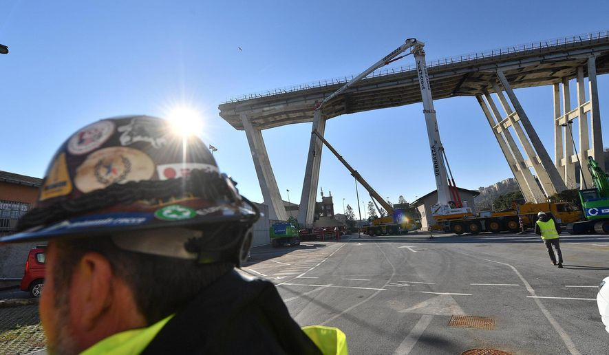 A view of the opening of the construction sites for the demolition of the collapsed Morandi highway bridge in Genoa, northern Italy, Saturday, Dec. 15, 2018.  Genoa's mayor is promising his city will have a new bridge by Christmas 2019 to replace the one that collapsed, killing 43 people. (Luca Zennaro/ANSa via AP)