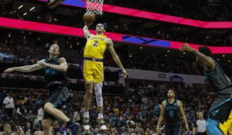 Los Angeles Lakers guard Lonzo Ball (2) dunks against Charlotte Hornets center Cody Zeller, left, in the second half of an NBA basketball game in Charlotte, N.C., Saturday, Dec. 15, 2018. (AP Photo/Nell Redmond)