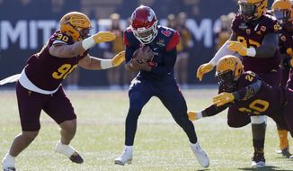 Fresno State quarterback Marcus McMaryion (6) runs for a gain against Arizona State during the first half of the Las Vegas Bowl NCAA college football game, Saturday, Dec. 15, 2018, in Las Vegas. (AP Photo/John Locher)