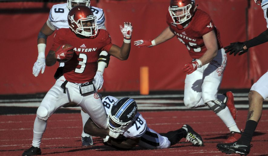 Eastern Washington quarterback Eric Barriere (3) runs the ball against Maine defensive back Shaquille St-Lot (28) during the second half of an NCAA college football game Saturday, Dec. 15, 2018, at Roos Field in Cheney, Wash. (Kathy Plonka/The Spokesman-Review via AP)