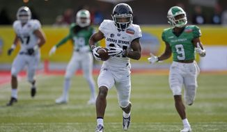 Utah State wide receiver Jalen Greene (21) sprints to the end zone to score a touchdown ahead of North Texas defensive back Nate Brooks (9) during the first half of the New Mexico Bowl NCAA college football game in Albuquerque, N.M., Saturday, Dec. 15, 2018. (AP Photo/Andres Leighton)
