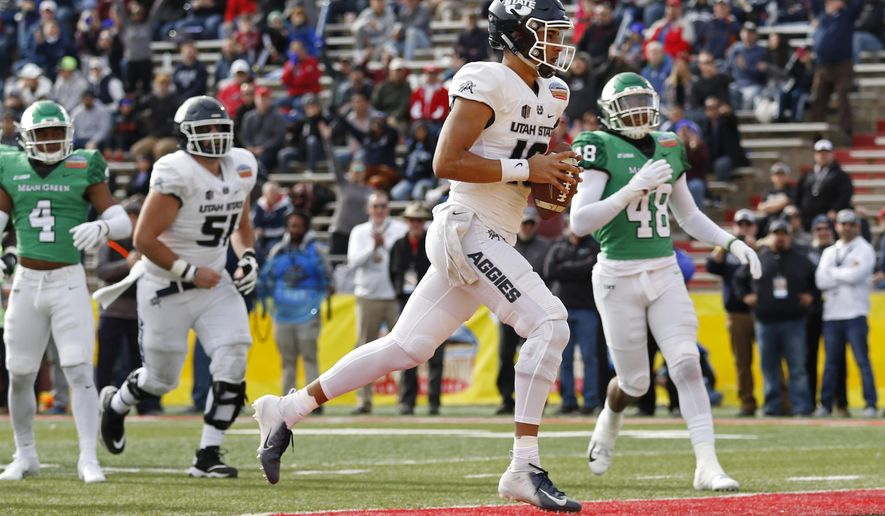 Utah State quarterback Jordan Love (10) scores a touchdown against North Texas during the first half of the New Mexico Bowl NCAA college football game in Albuquerque, N.M., Saturday, Dec. 15, 2018. (AP Photo/Andres Leighton)