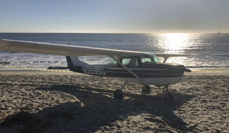 In this photo released by the Orange County Fire Authority, (OCFA), a small airplane that touched down on Doheny State Beach is seen in the sand Saturday, Dec. 15, 2018, in Dana Point, Calif. The small-engine plane made an emergency landing on a Southern California beach but no one aboard or on the ground was hurt. The OCFA says the Cessna airplane touched down on the beach Saturday afternoon, on an empty stretch of sand, away from beachgoers. (Fire Capt. Tony Bommarito/OCFA via AP)