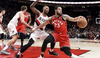 Toronto Raptors guard Fred VanVleet, right, tries to get past Portland Trail Blazers guard Damian Lillard, left, during the first half of an NBA basketball game in Portland, Ore., Friday, Dec. 14, 2018. (AP Photo/Steve Dykes)