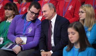 Russian President Vladimir Putin, center, attends a high-tech forum for youth in Yaroslavl, Russia, Thursday, Dec. 13, 2018. Putin said that Russia has a big potential for the development of high-tech industries. (Alexei Druzhinin, Sputnik, Kremlin Pool Photo via AP)