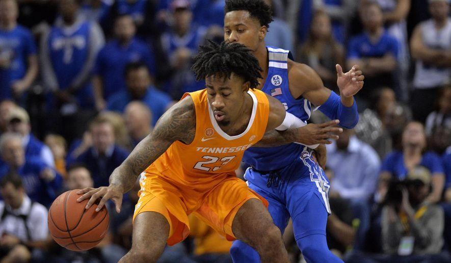 Tennessee guard Jordan Bowden (23) controls the ball against Memphis guard Tyler Harris in the first half of an NCAA college basketball game Saturday, Dec. 15, 2018, in Memphis, Tenn. (AP Photo/Brandon Dill)
