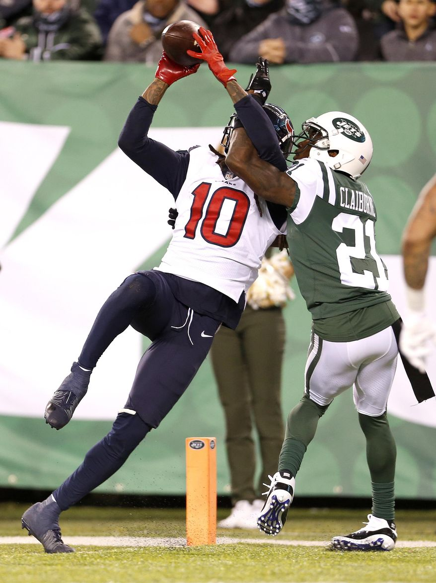 Houston Texans wide receiver DeAndre Hopkins (10) makes a touchdown catch on a pass from quarterback Deshaun Watson, not pictured, as New York Jets cornerback Morris Claiborne (21) defends during the second half of an NFL football game, Saturday, Dec. 15, 2018, in East Rutherford, N.J. The Texans won 29-22. (AP Photo/Adam Hunger)