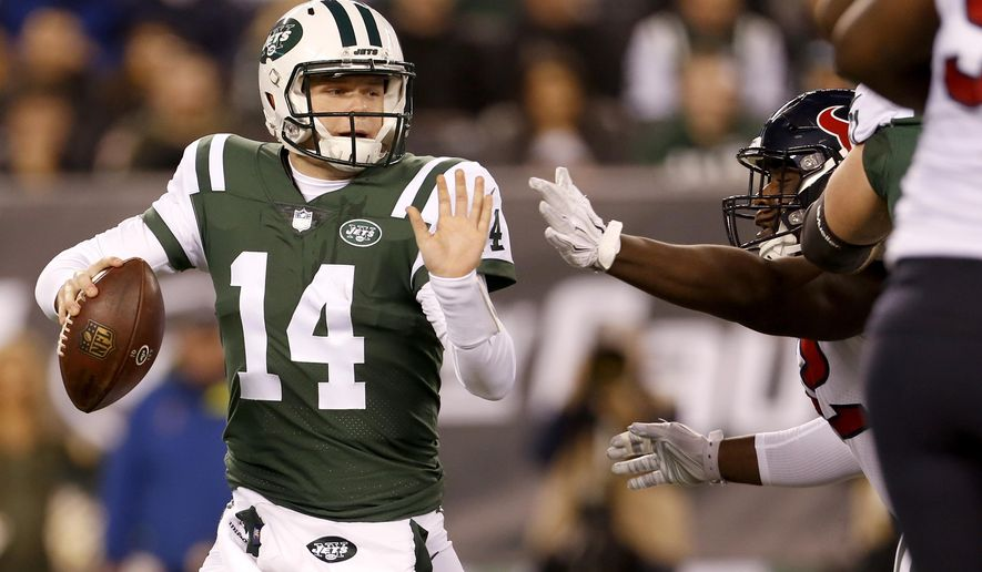 New York Jets quarterback Sam Darnold (14) tries to avoid a sack from Houston Texans nose tackle Brandon Dunn during the first half of an NFL football game, Saturday, Dec. 15, 2018, in East Rutherford, N.J. (AP Photo/Adam Hunger)