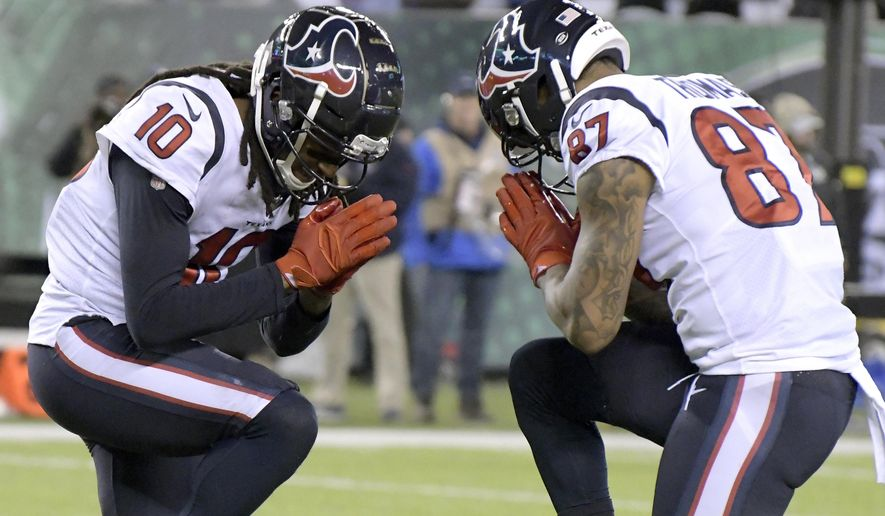 Houston Texans wide receiver DeAndre Hopkins (10) celebrates his touchdown catch with wide receiver Demaryius Thomas (87) during the first half of an NFL football game, Saturday, Dec. 15, 2018, in East Rutherford, N.J. (AP Photo/Bill Kostroun)