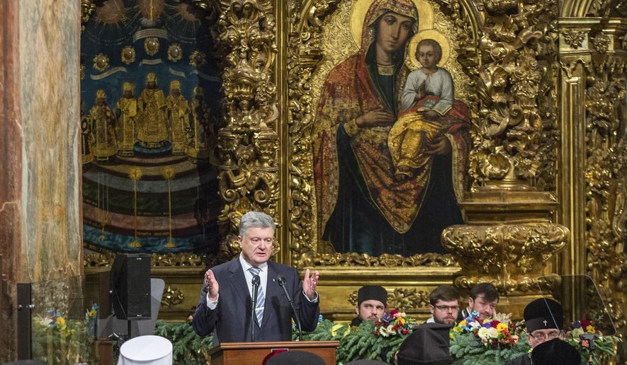 """Ukrainian President Petro Poroshenko gestures while speaking at a closed-door synod of three Ukrainian Orthodox churches to approve the charter for a unified church and to elect leadership in the St. Sophia Cathedral in Kiev, Ukraine, Saturday, Dec. 15, 2018.  Poroshenko has told the crowd """"the creation of our Church is another declaration of Ukraine's independence and you are the main participants of this historic event."""" (Mykhailo Markiv, Ukrainian Presidential Press Service/Pool Photo via AP)"""