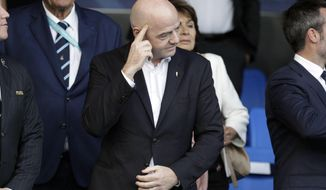 FIFA President Gianni Infantino, gestures before the 2018 FIFA U-17 Women's World Cup final soccer match between Mexico and Spain in Montevideo, Uruguay, Saturday, Dec. 1, 2018. (AP Photo/Matilde Campodonico)