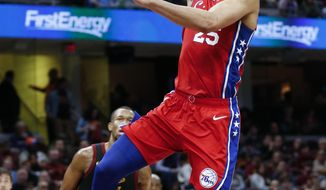 Philadelphia 76ers' Ben Simmons (25), from Australia, shoots against Cleveland Cavaliers' Rodney Hood (1) during the second half of an NBA basketball game Sunday, Dec. 16, 2018, in Cleveland. (AP Photo/Ron Schwane)