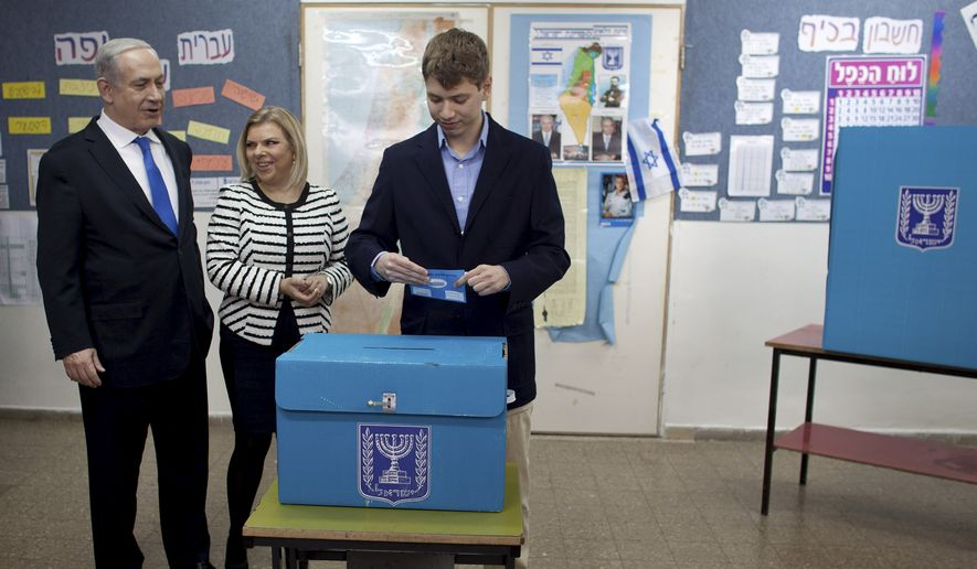 Yair Netanyahu, the son ofIsraeli Prime Minister Benjamin Netanyahu, left, casts his ballottogether with his parents at a polling station in Jerusalem, Tuesday, Jan. 22, 2013.Israelis headed to polling stations Tuesday to cast votes in a parliamentary election expected to return Netanyahu to office despite years of stalled peacemaking with the Palestinians and mounting economic troubles. (AP Photo/Uriel Sinai, Pool)