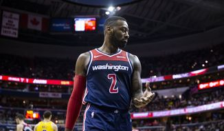 Washington Wizards guard John Wall (2) walks off court during the second half of an NBA basketball game, Sunday, Dec. 16, 2018, in Washington. Washington won 128-1110. (AP Photo/Al Drago)