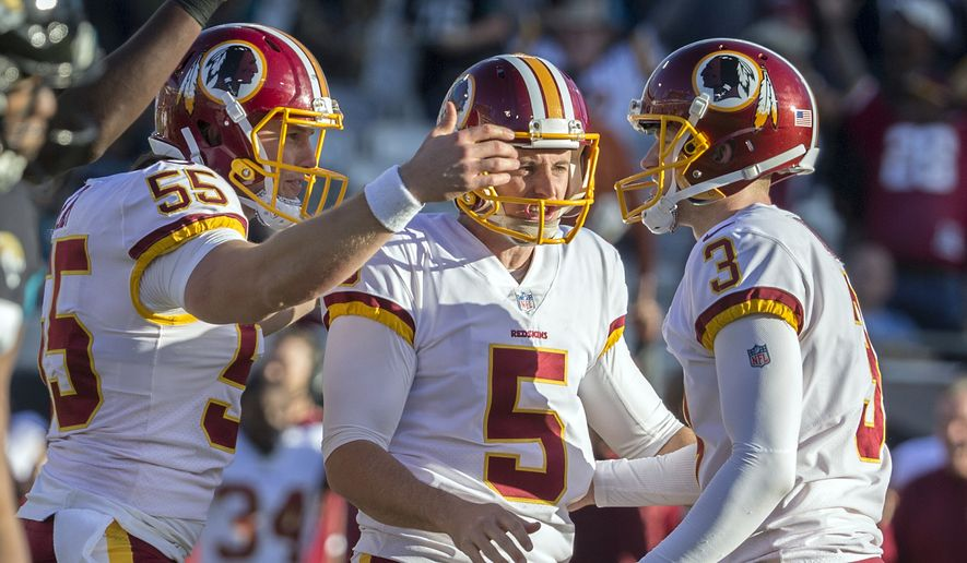 Washington Redskins kicker Dustin Hopkins (3) celebrates with his teammates Washington punter Tress Way (5) and Washington long snapper Andrew East (55) during the second half of an NFL football game, Sunday, Dec. 16, 2018, in Jacksonville, Fla. (AP Photo/Stephen B. Morton)