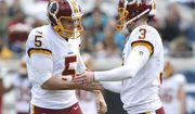 Washington Redskins kicker Dustin Hopkins (3) celebrates a field goal against the Jacksonville Jaguars with teammate Tress Way (5) during the first half of an NFL football game, Sunday, Dec. 16, 2018, in Jacksonville, Fla. (AP Photo/Stephen B. Morton)