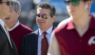 Washington Redskins owner Daniel Snyder, center, speaks with associates on the sidelines before the start of an NFL football game against the Jacksonville Jaguars, Sunday, Dec. 16, 2018, in Jacksonville, Fla. (AP Photo/Stephen B. Morton)