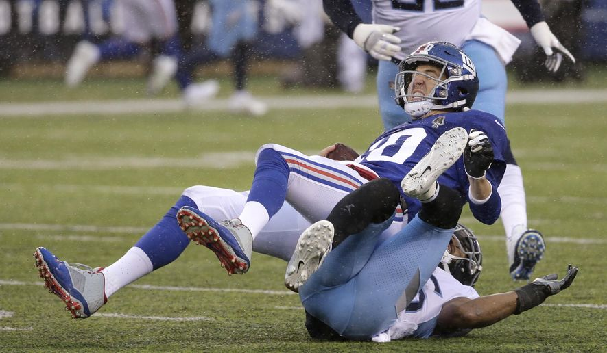 New York Giants quarterback Eli Manning, top, is sacked by Tennessee Titans cornerback Logan Ryan during the first half of an NFL football game, Sunday, Dec. 16, 2018, in East Rutherford, N.J. (AP Photo/Seth Wenig)