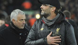Liverpool manager Juergen Klopp, right, and Manchester United manager Jose Mourinho seen prior to the English Premier League soccer match between Liverpool and Manchester United at Anfield in Liverpool, England, Sunday, Dec. 16, 2018. (AP Photo/Rui Vieira)