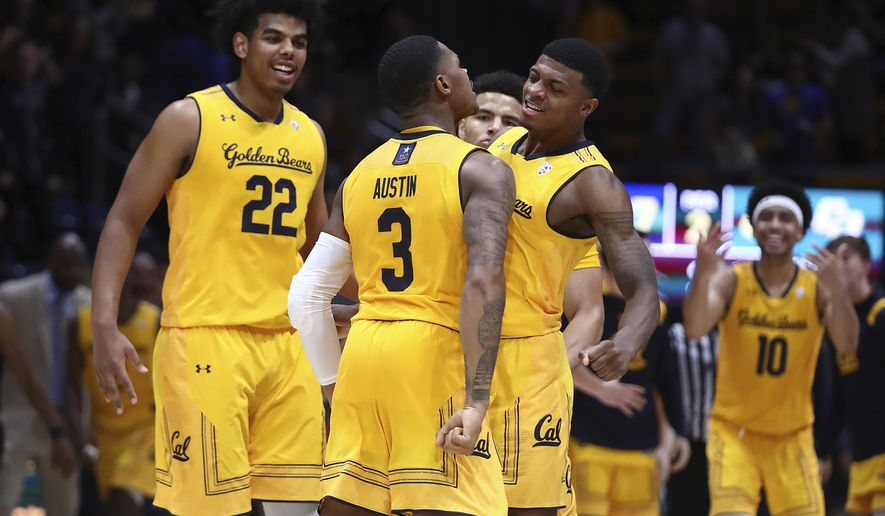 California's Paris Austin (3) celebrates with Darius McNeill, right, and Andre Kelly (22) after making the game winning score against Cal Poly in the second half of an NCAA college basketball game Saturday, Dec. 15, 2018, in Berkeley, Calif. (AP Photo/Ben Margot)