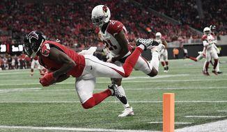 Atlanta Falcons wide receiver Julio Jones (11) makes a touchdown catch against Arizona Cardinals cornerback Patrick Peterson (21) during the first half of an NFL football game, Sunday, Dec. 16, 2018, in Atlanta. (AP Photo/Danny Karnik)