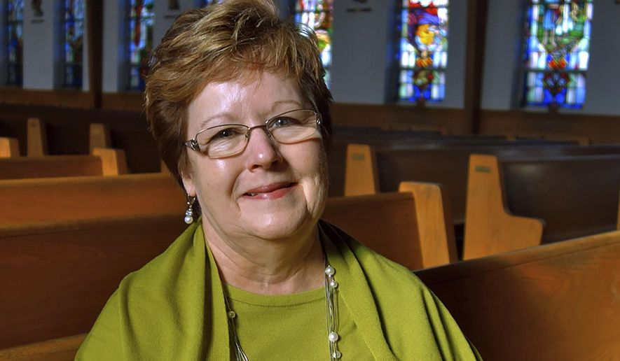 In this Dec. 7, 2018 photo provided by the Diocese of Bridgeport, Eleanor Sauers sits inside Saint Anthony of Padua Roman Catholic Church in Fairfield, Conn. Sauers, a lay woman, has been put in charge of the local parish months after the death of its priest. Her official title will be parish life coordinator and she takes the new position in January. Bishop Frank J. Caggiano has given her decision-making authority at the church, where a team of priests will say Mass and perform other ministerial duties. (Joe Pisani/Diocese of Bridgeport via AP)