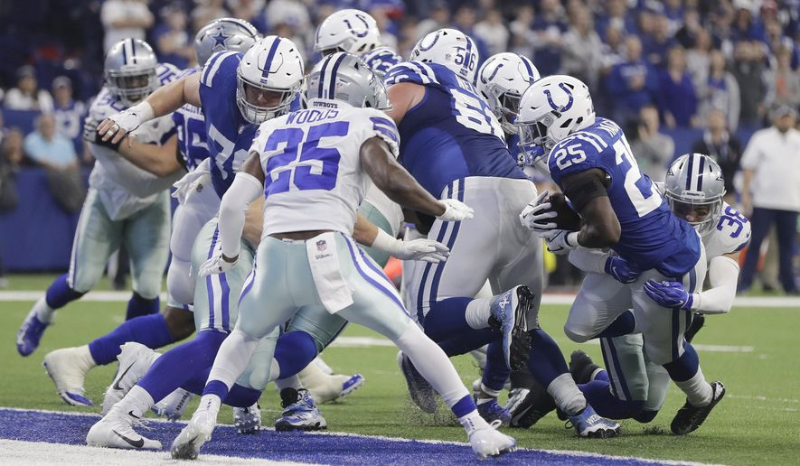 Indianapolis Colts running back Marlon Mack (25) scores a touchdown while being tackled by Dallas Cowboys strong safety Jeff Heath (38) during the first half of an NFL football game, Sunday, Dec. 16, 2018, in Indianapolis. (AP Photo/Darron Cummings)