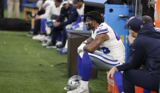 Dallas Cowboys' Rod Smith watches from the bench during the second half of an NFL football game against the Indianapolis Colts, Sunday, Dec. 16, 2018, in Indianapolis. (AP Photo/Michael Conroy)