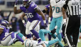 Minnesota Vikings defensive tackle Tom Johnson (96) celebrates after sacking Miami Dolphins quarterback Ryan Tannehill during the second half of an NFL football game, Sunday, Dec. 16, 2018, in Minneapolis. (AP Photo/Andy Clayton-King)