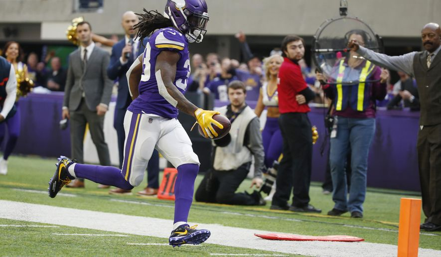 Minnesota Vikings running back Dalvin Cook scores on a 13-yard touchdown run in the first half of an NFL football game against the Miami Dolphins, Sunday, Dec. 16, 2018, in Minneapolis. (AP Photo/Bruce Kluckhohn)