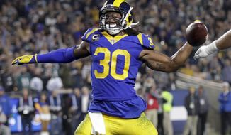Los Angeles Rams running back Todd Gurley celebrates after scoring against the Philadelphia Eagles during the first half in an NFL football game Sunday, Dec. 16, 2018, in Los Angeles. (AP Photo/Marcio Jose Sanchez)