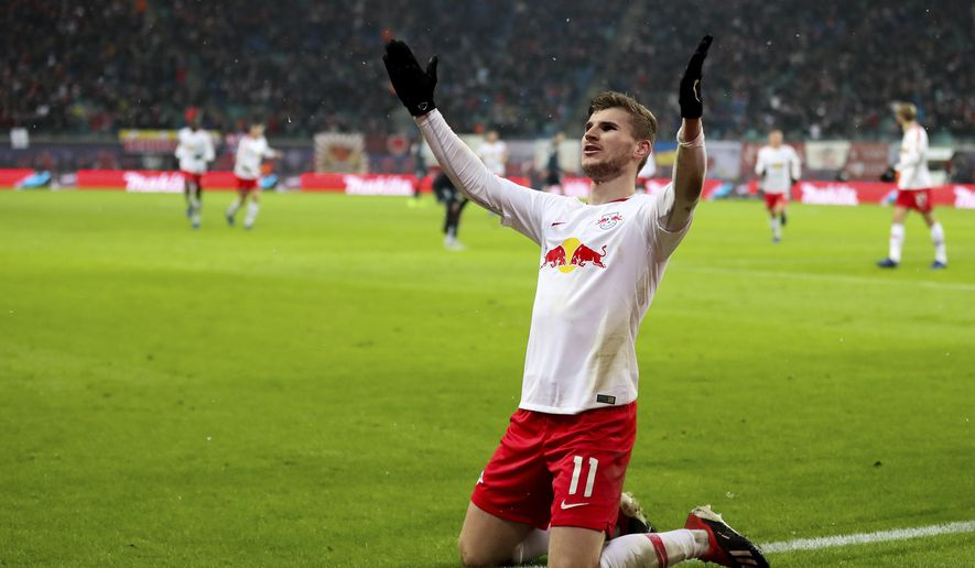 Leipzig's Timo Werner celebrates his side third goal during the German Bundesliga soccer match between RB Leipzig and FSV Mainz 05 in Leipzig, Sunday, Dec. 16, 2018. (Jan Woitas/dpa via AP)
