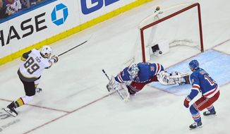 Vegas Golden Knights' Alex Tuch, (89) scores his goal during overtime of an NHL hockey game against the New York Rangers Sunday, Dec. 16, 2018, in New York. (AP Photo/Andres Kudacki)
