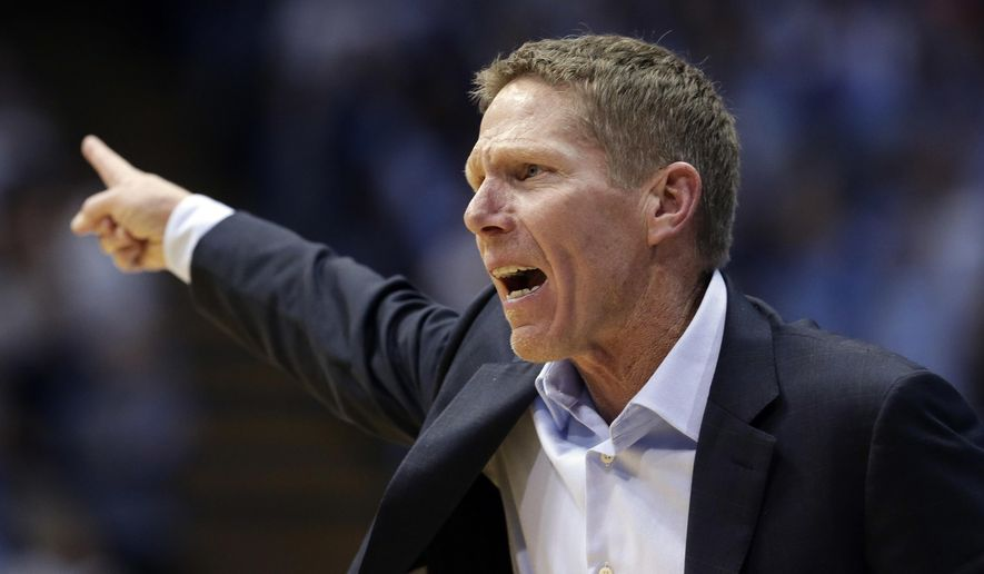 Gonzaga head coach Mark Few directs his team during the second half of an NCAA college basketball game against North Carolina in Chapel Hill, N.C., Saturday, Dec. 15, 2018. (AP Photo/Gerry Broome)