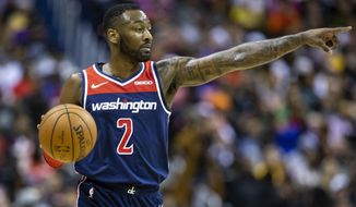 Washington Wizards guard John Wall (2) dribbles the ball during the second half of an NBA basketball game, Sunday, Dec. 16, 2018, in Washington. Washington won 128-1110. (AP Photo/Al Drago) ** FILE **