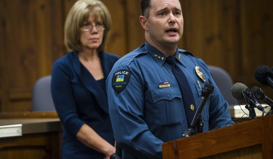 FILE - In this undated file photo, Woodland Park Police Chief Miles De Young answers questions about the disappearance of resident Kelsey Berreth, while her mother, Cheryl Berreth, stands in the background during a news conference at City Hall in Woodland Park, Colo. Police are offering a $25,000 reward for information leading to the whereabouts of Berreth, a Colorado woman who was last seen on Thanksgiving Day. (Christian Murdock/The Gazette via AP, File)