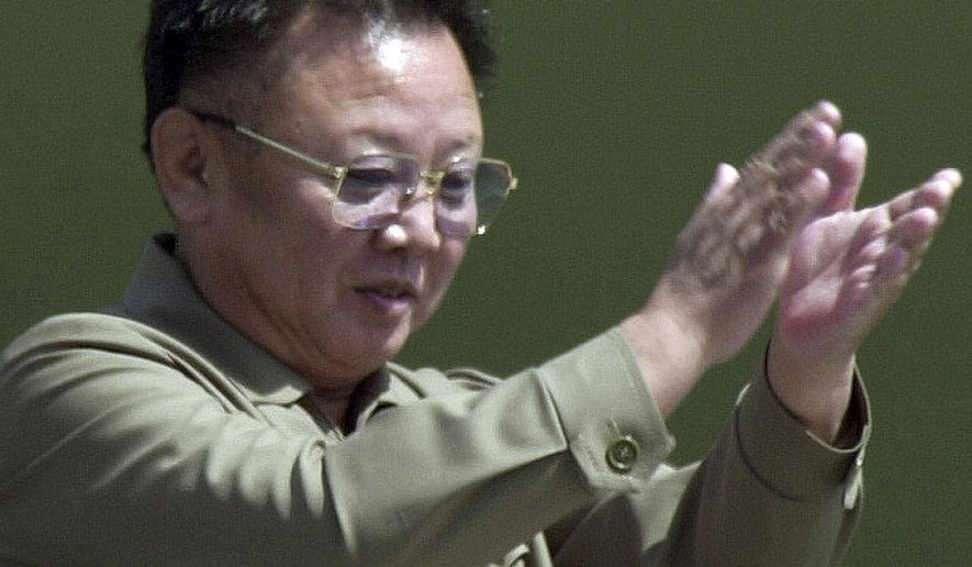 FILE - In this April 25, 2002, file photo, then North Korean leader Kim Jong Il claps from the balcony as soldiers salute him during a military parade, celebrating the foundation of the armed forces in Pyongyang, North Korea. North Koreans are marking the anniversary of the death of leader Kim Jong Il seven years ago with visits to statues and vows of loyalty to his son, Kim Jong Un. (AP Photo/Katsumi Kasahara, File)