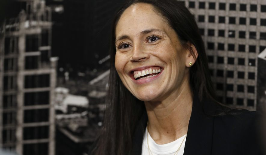 Sue Bird jokes with reporters as she talks about her new role as basketball operations assistant for the Denver Nuggets before an NBA basketball game Sunday, Dec. 16, 2018, in Denver. (AP Photo/David Zalubowski)