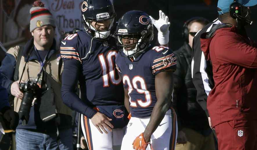 Chicago Bears quarterback Mitchell Trubisky (10) and running back Tarik Cohen (29) celebrate a touchdown during the first half of an NFL football game against the Green Bay Packers Sunday, Dec. 16, 2018, in Chicago. (AP Photo/David Banks)