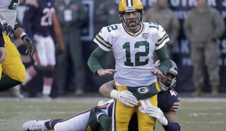Green Bay Packers quarterback Aaron Rodgers (12) is tackled by Chicago Bears linebacker Isaiah Irving (47) during the second half of an NFL football game Sunday, Dec. 16, 2018, in Chicago. (AP Photo/Nam Y. Huh)