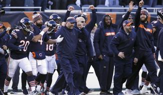 Chicago Bears head coach Matt Nagy celebrates with his team after an NFL football game against the Green Bay Packers Sunday, Dec. 16, 2018, in Chicago. The Bears won 24-17. (AP Photo/David Banks)