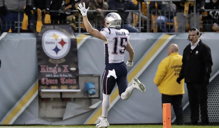 New England Patriots wide receiver Chris Hogan (15) scores after taking a pass from quarterback Tom Brady during the first half of an NFL football game against the Pittsburgh Steelers in Pittsburgh, Sunday, Dec. 16, 2018. (AP Photo/Don Wright)