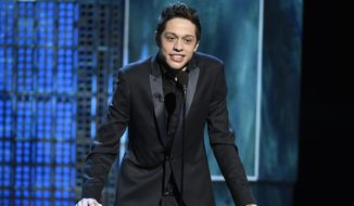 "FILE - In this March 14, 2015, file photo, Pete Davidson speaks at a Comedy Central Roast at Sony Pictures Studios in Culver City, Calif. New York police were concerned about Davidson after he wrote ""I don't want to be on this earth anymore"" on Instagram. And they visited the ""Saturday Night Live"" star Saturday, Dec. 15, 2018, to make sure he was OK. (Photo by Chris Pizzello/Invision/AP, File)"