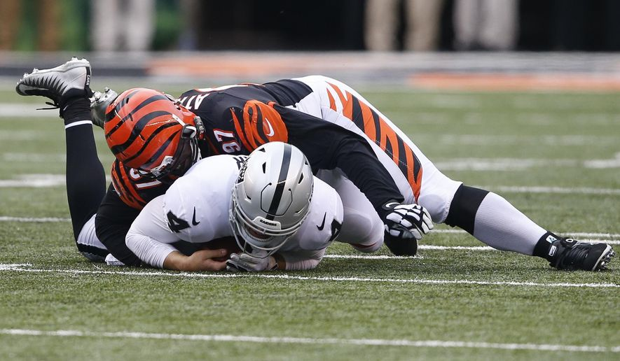 Cincinnati Bengals defensive tackle Geno Atkins (97) sacks Oakland Raiders quarterback Derek Carr (4) in the second half of an NFL football game, Sunday, Dec. 16, 2018, in Cincinnati. (AP Photo/Gary Landers)