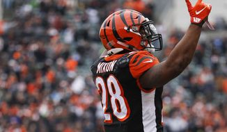 Cincinnati Bengals running back Joe Mixon celebrates his touchdown in the first half of an NFL football game against the Oakland Raiders, Sunday, Dec. 16, 2018, in Cincinnati. (AP Photo/Frank Victores)