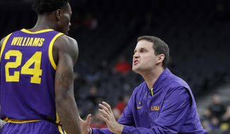LSU head coach Will Wade, right, talks with Emmitt Williams during the first half of an NCAA college basketball game against Saint Mary's on Saturday, Dec. 15, 2018, in Las Vegas. (AP Photo/Isaac Brekken)