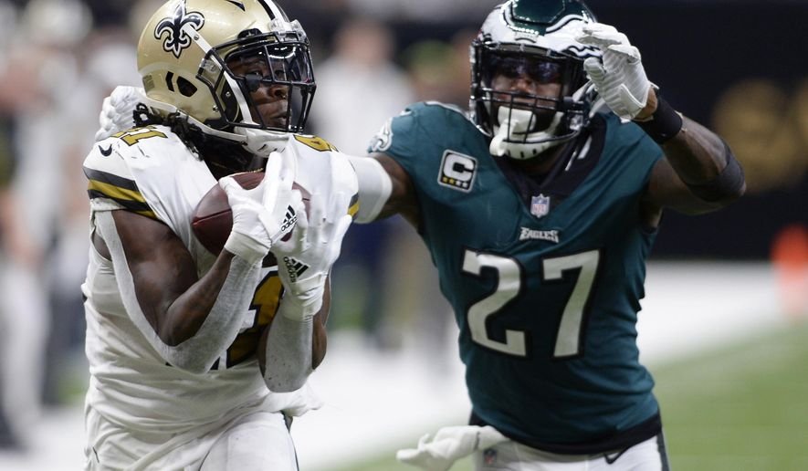 FILE - In this Nov. 18, 2018, file photo, New Orleans Saints running back Alvin Kamara (41) pulls in a touchdown reception in front of Philadelphia Eagles strong safety Malcolm Jenkins (27) during the second half of an NFL football game in New Orleans. Kamara figures to play a prominent role in the Saints game Monday, Dec. 17, night at Carolina .(AP Photo/Bill Feig, File)
