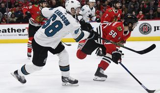 San Jose Sharks center Melker Karlsson (68) scores past Chicago Blackhawks defenseman Erik Gustafsson (56) during the first period of an NHL hockey game Sunday Dec. 16, 2018, in Chicago. (AP Photo/Matt Marton)